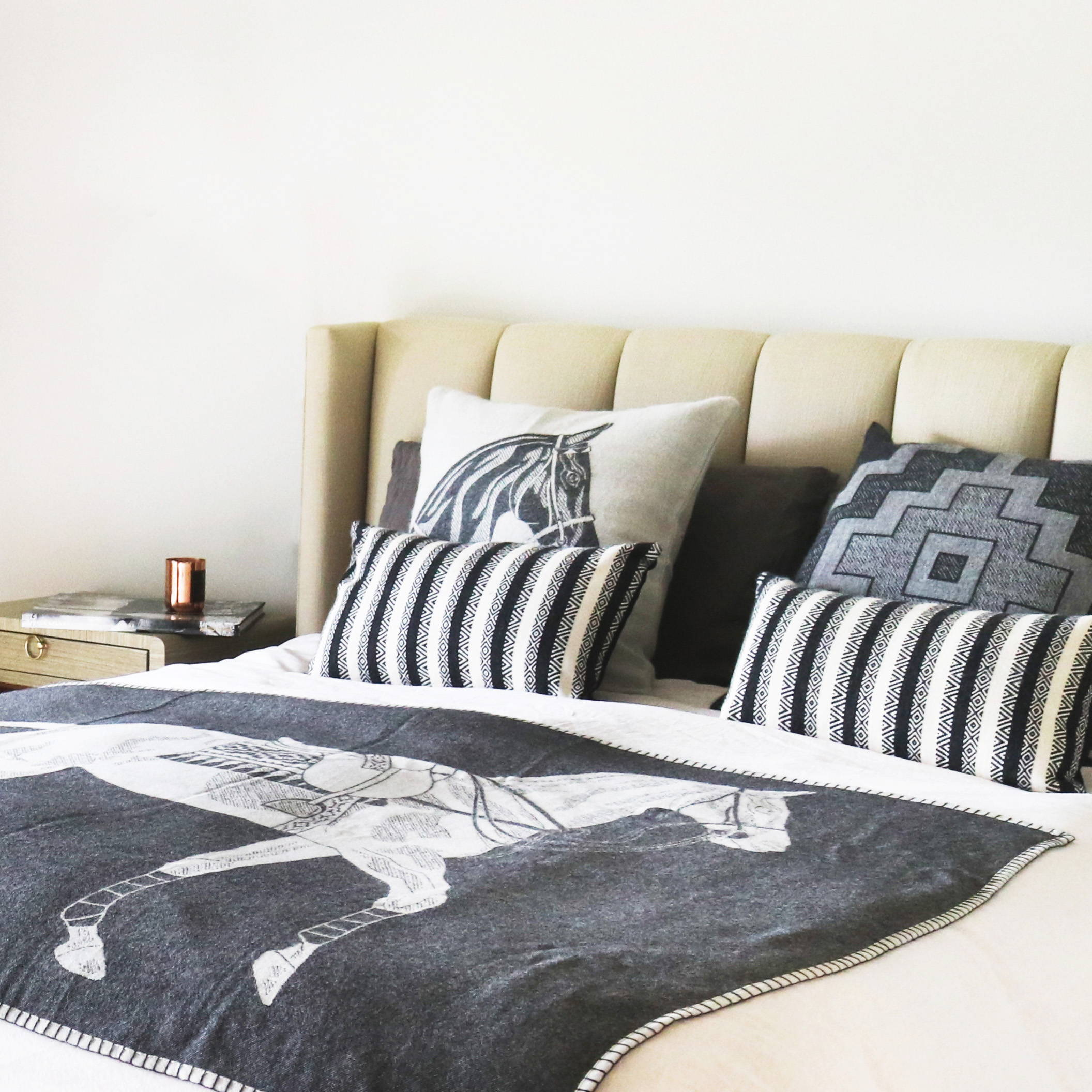 Bedroom display of Alpaca Decorative Pillows with the Alpaca Polo Pony Throw Blanket - Stick & Ball