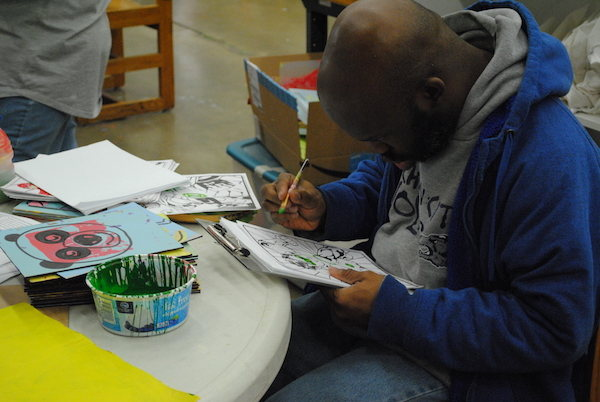 Image of a man coloring