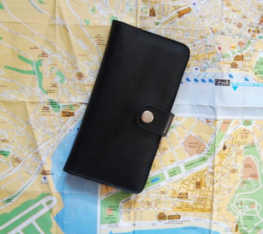 Черное кожаное портмоне на кнопке