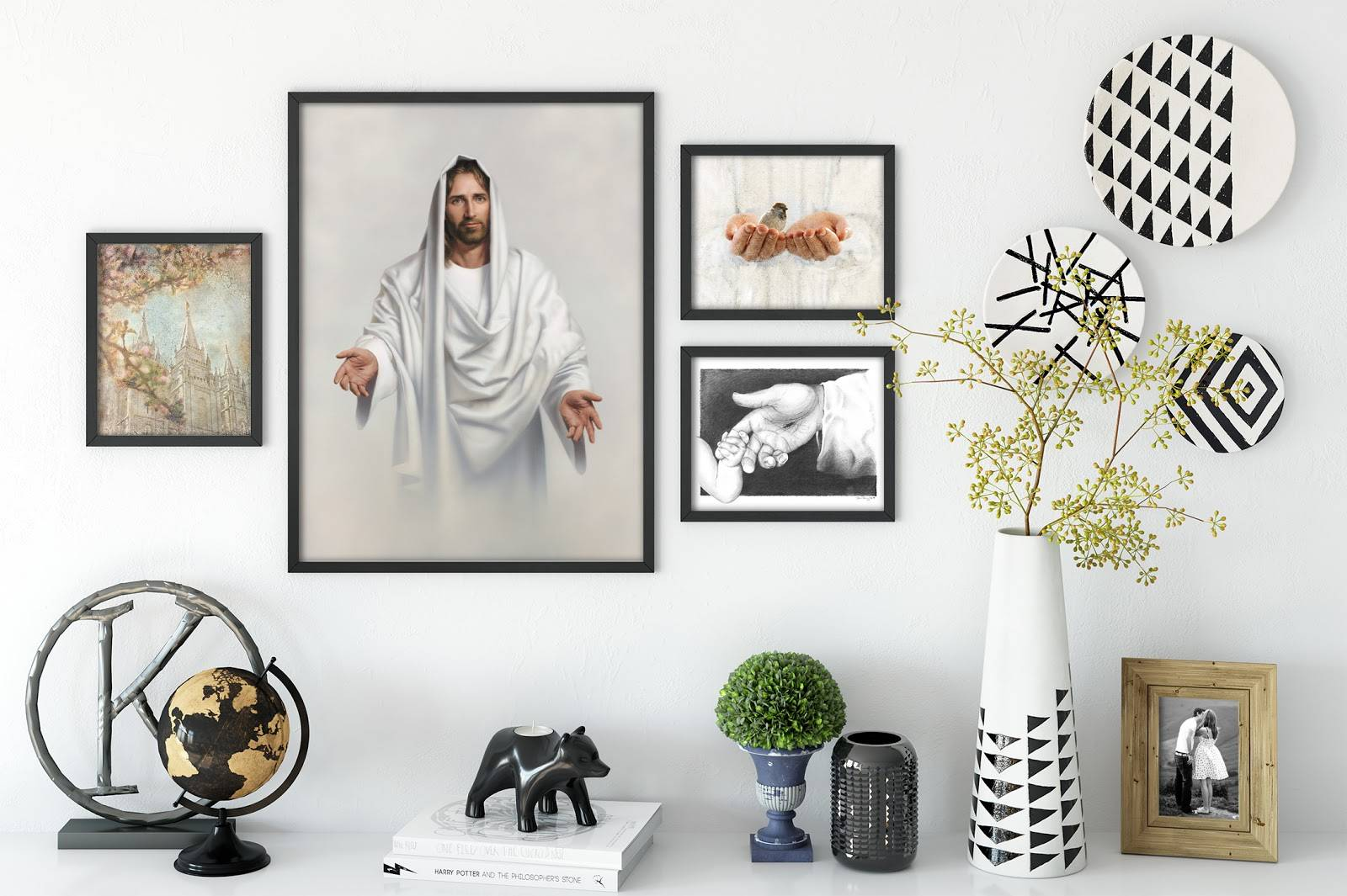 Various sizes of small wall art places together among color complimenting accent pieces.