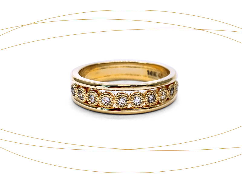 Yellow gold eternity ring with diamonds in small circles welded on the ring body.