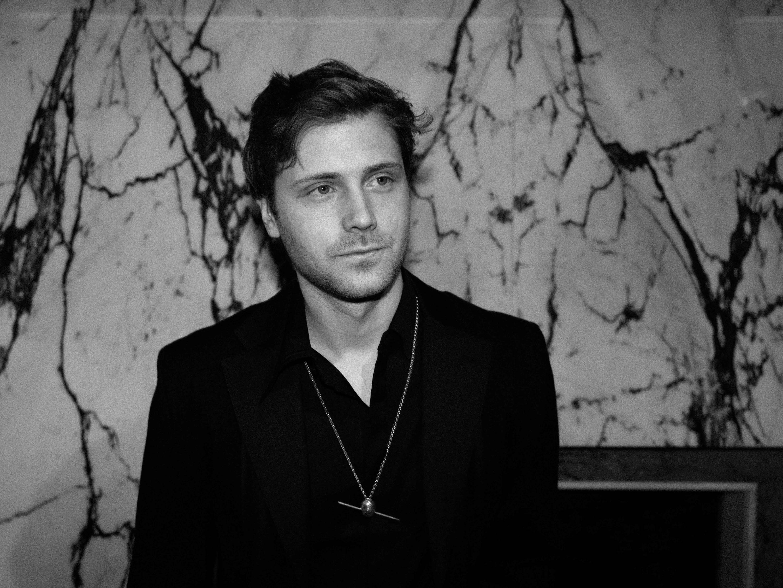 Patrick wearing Hans jacket black and Martiini olive necklace