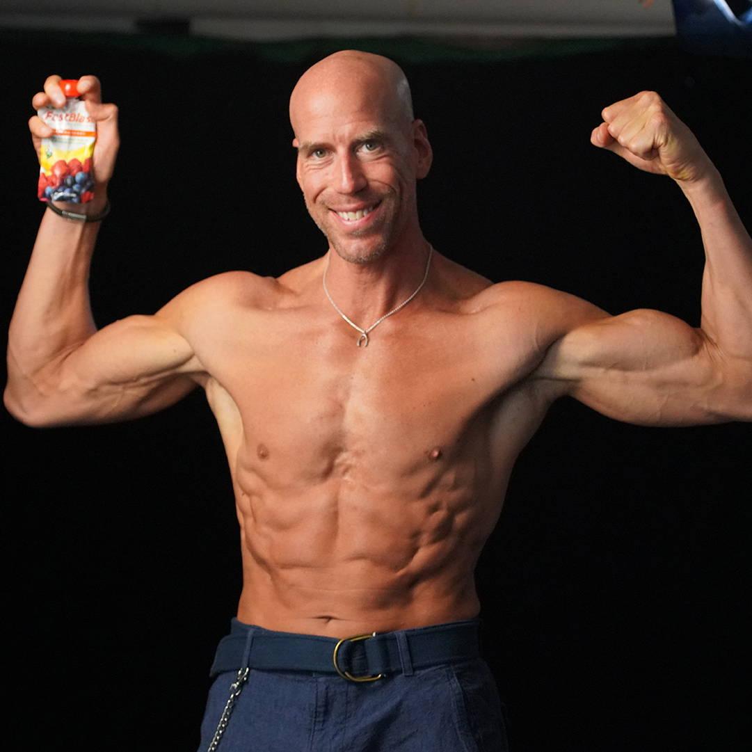 In shape man holding fastblast smoothie