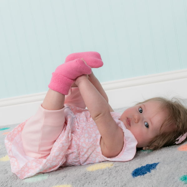 child with infant girl socks
