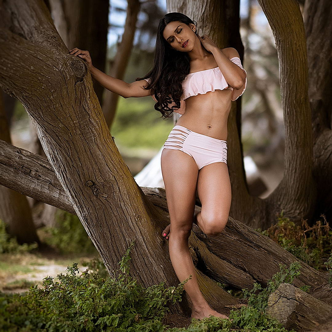 indian girl in a forrest wearing pink off the shoulder ruffled bikini