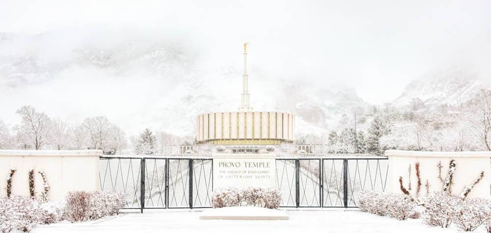 Provo Temple amid a snowy landscape.