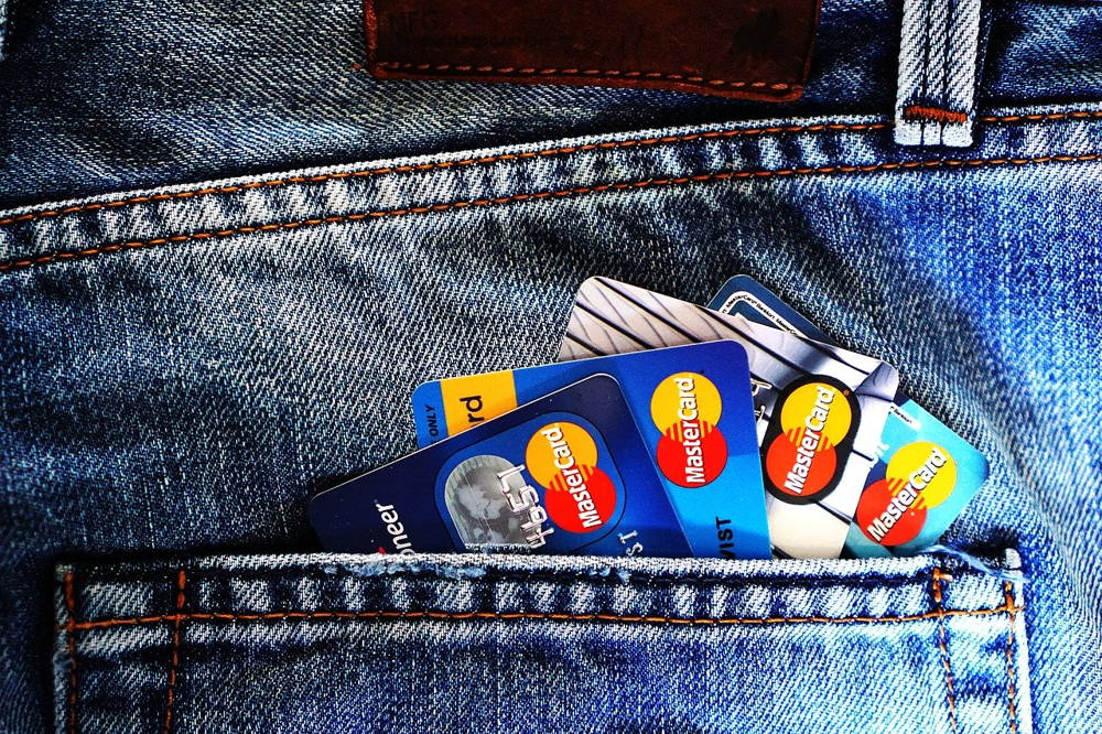 image of jeans back pocket with credit cards stacked inside