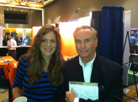 Greg Friedman, president of Junxure with Amy Flourry, operations manager for Rehmann Financial.