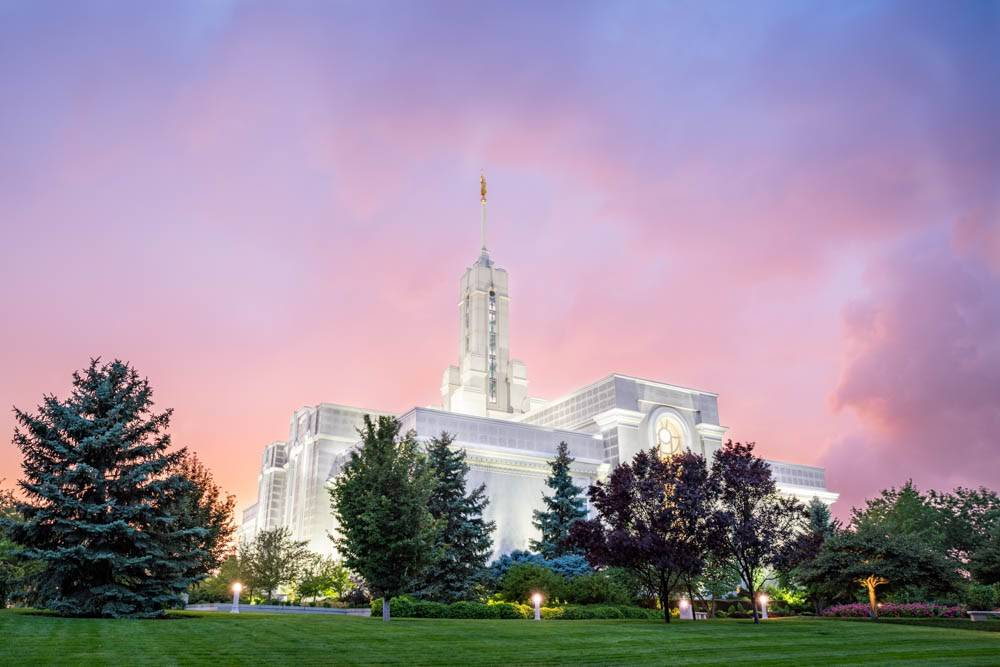 LDS art painting of Mt Timpanogos Temple in front of a colorful sky.