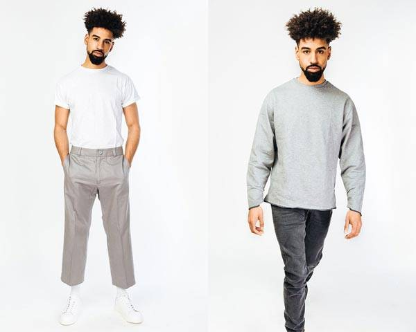 Man wearing white organic cotton t-shirt with rolled up sleeve and cropped grey trouser and white trainers alongside man wearing grey long sleeve t-shirt and black slim black denim