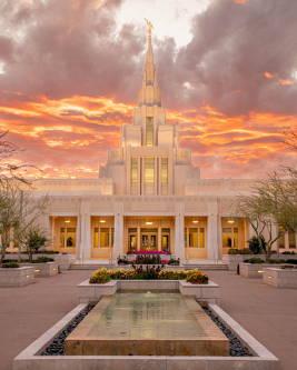 Phoenix Temple against orange clouds.