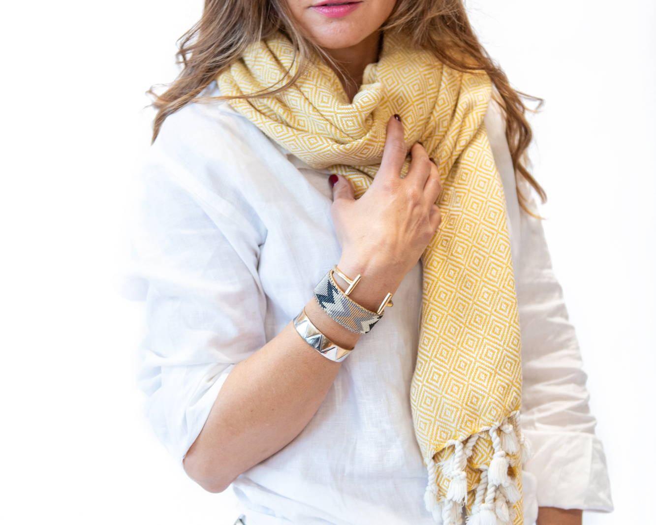 Woman wearing white linen button down with handwoven cotton diamond scarf in yellow & assortment of jewelry - Stick & Ball