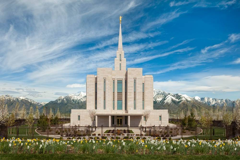LDS art photo of the the Oquirrh Mountain Temple among spring blossoms.