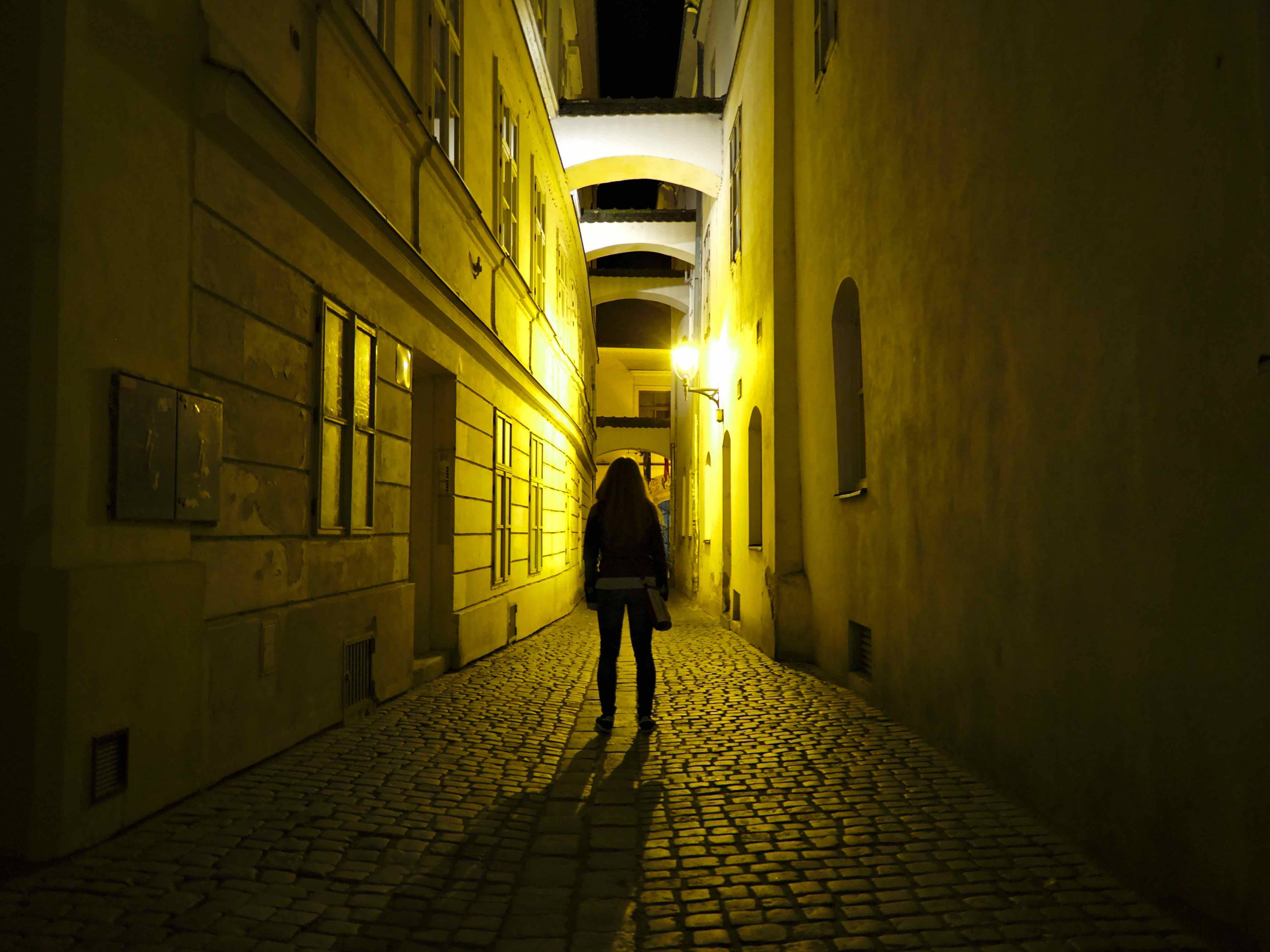 Woman in alleyway at night