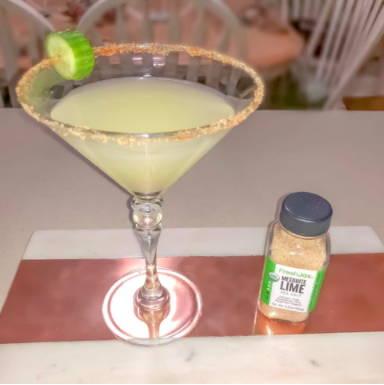 A margarita next to a small bottle of FreshJax Organic Mesquite Lime Sea Salt.