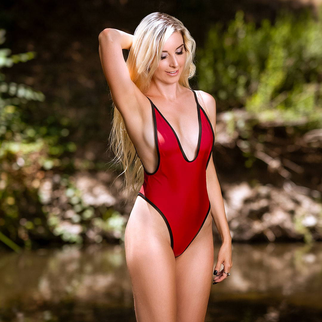 Blonde woman in solid color monokini