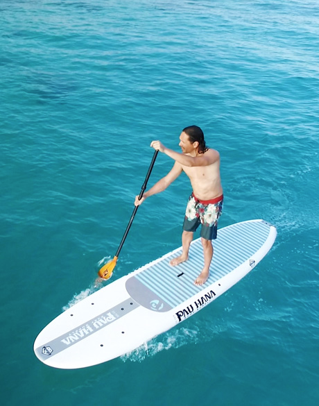 Todd surfing on his Big Ez Ricochet board by Pau Hana surf supply