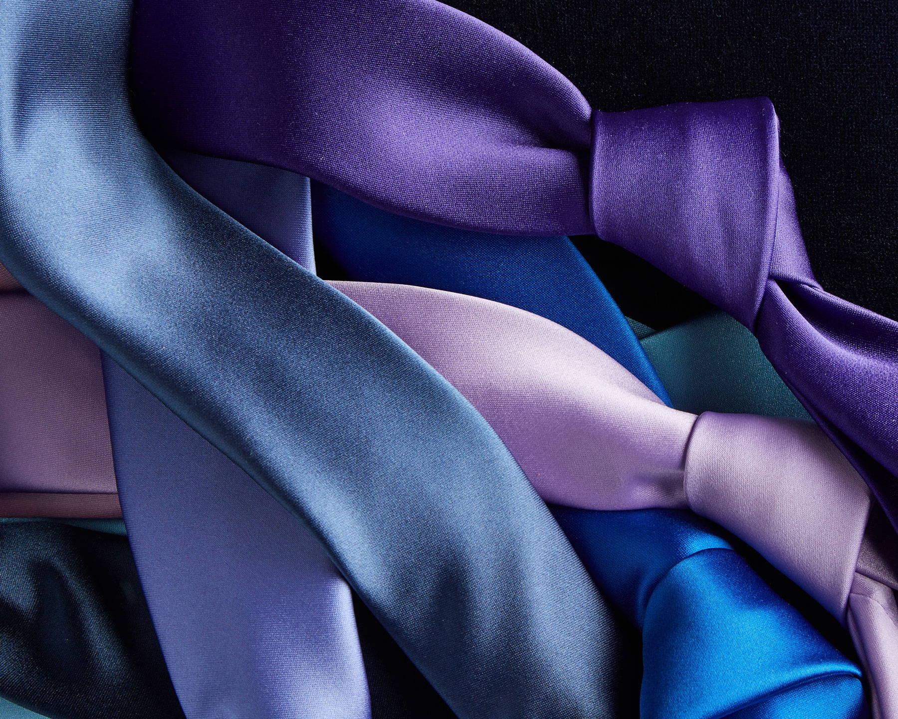 Purple satin ties laid flat
