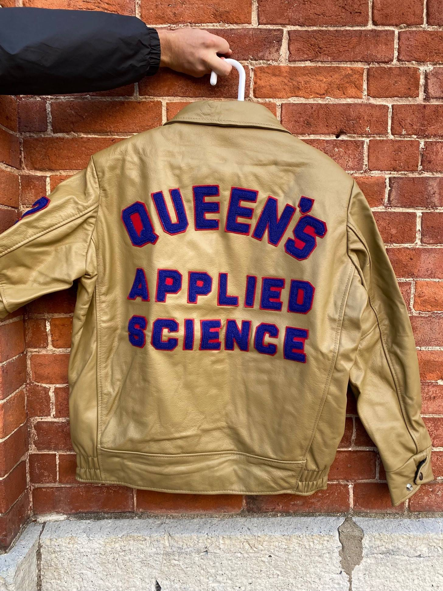 Pictured is a Unisex Sci' 22 Jacket, Size 42