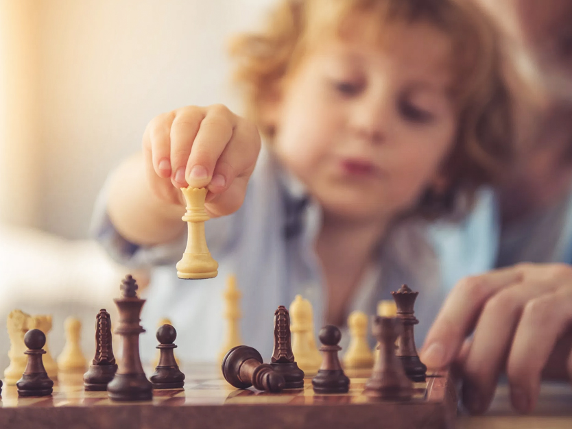 6-benefits-of-teaching-kids-to-play-chess -curtainsnmore