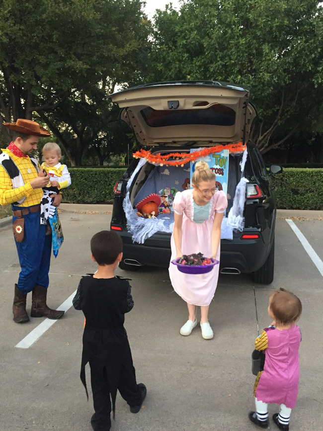 kids in Halloween costumes at trunk or treat