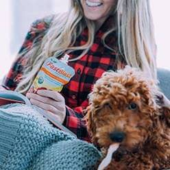 Women with dog and fastblast smoothie