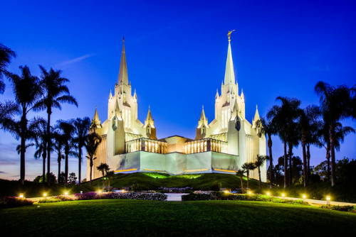 The San Diego Temple glowing against an evening sky.