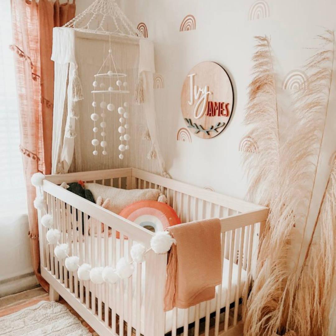 boho theme neutral nursery with crib and crib canopy