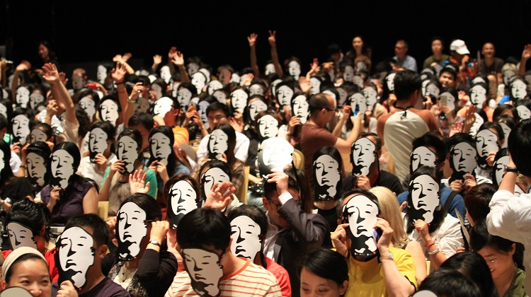 A film festival audience wearing Alfred Hitchcock masks