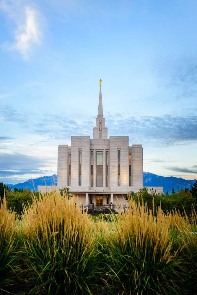 LDS art vertical photo of the Oquirrh Mountain Temple amid tall grass.