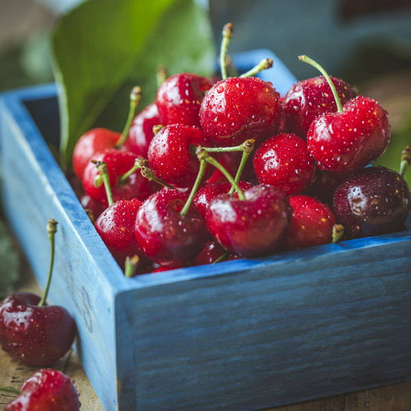Cherries in a wooden box