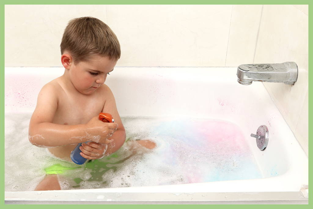 Messy play in a bath tub creates a clear boundary
