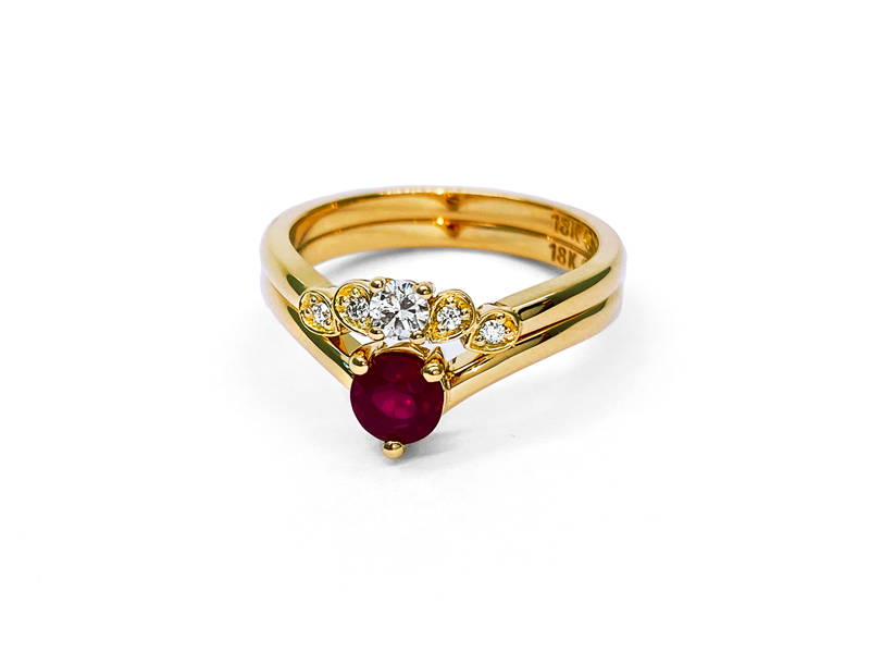 Duo engagement and wedding ring in yellow gold with diamonds and ruby as the main stone.