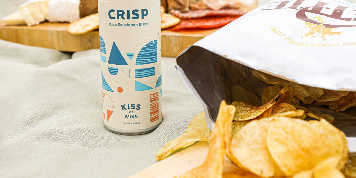 Salt and vinegar crisps opened at a picnic paired with Kiss of Wine light Sauvignon Blanc.