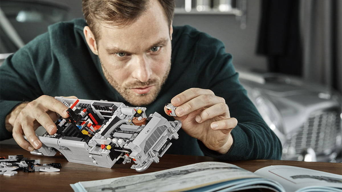 adult play with LEGO
