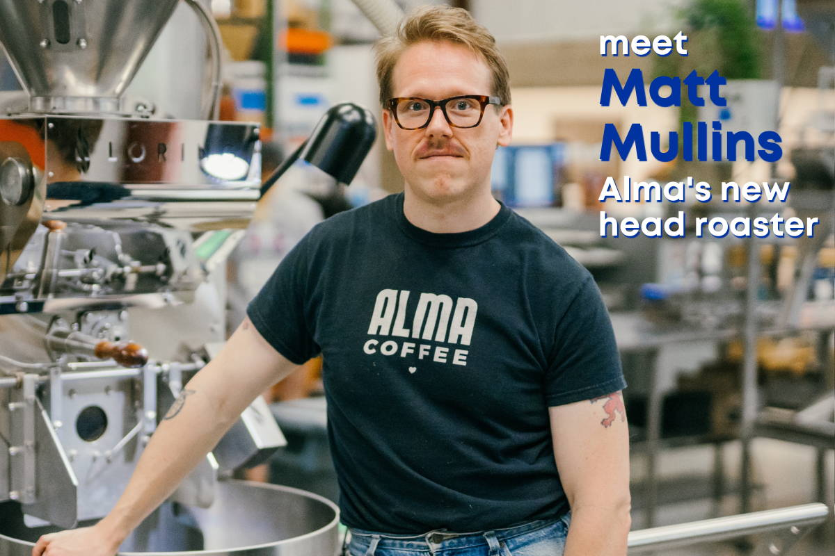 Man standing in front of a coffee roaster