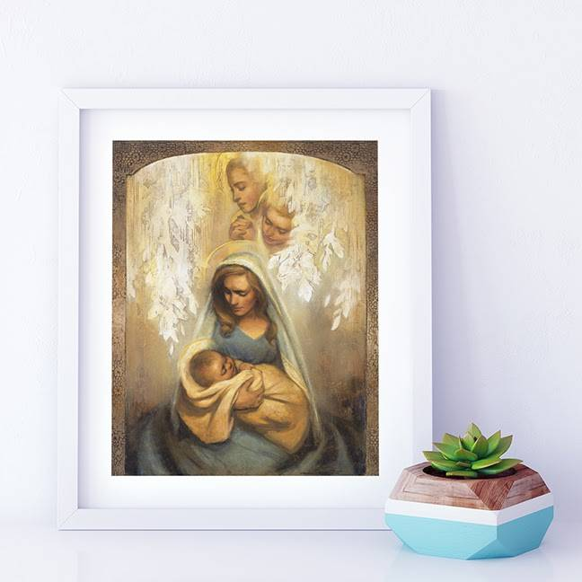 Small art painting of a mother holding an infant while angels watch over her. The painting is placed next to a small succulent plant.