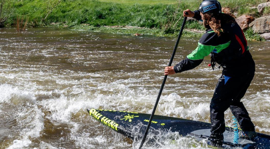 Kevin on the Pau Hana phantom sup river racing board