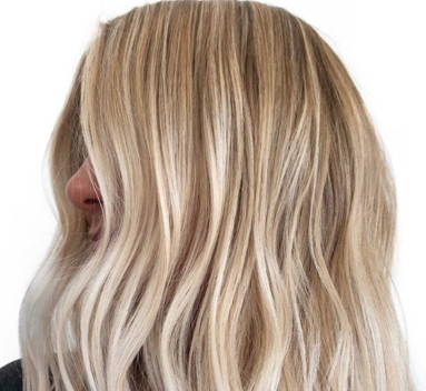photo of a woman from the side with light blonde wavy hair
