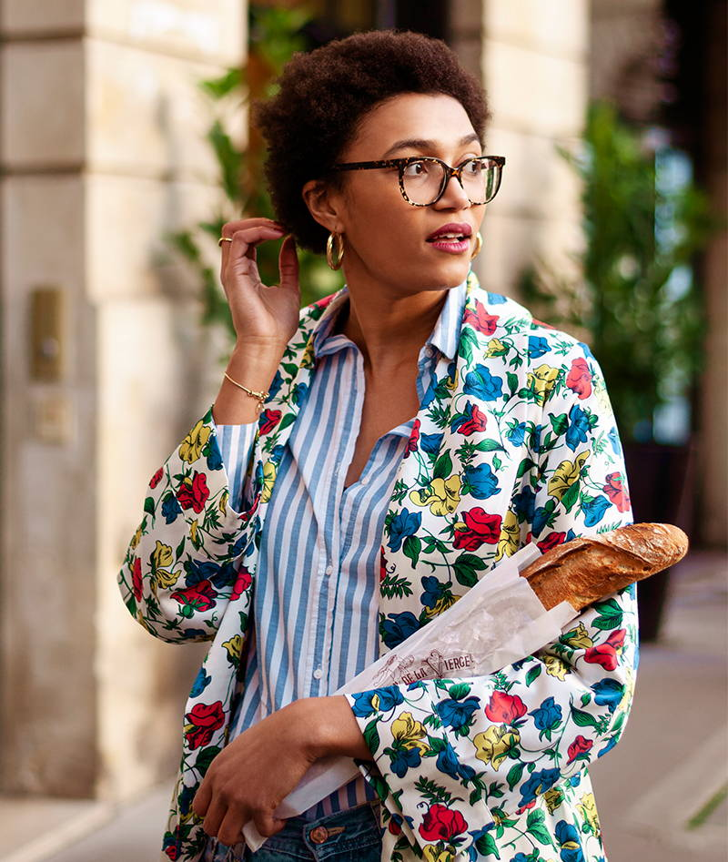Lena Farl YOLKE Girl wearing floral jacket and striped blue shirt