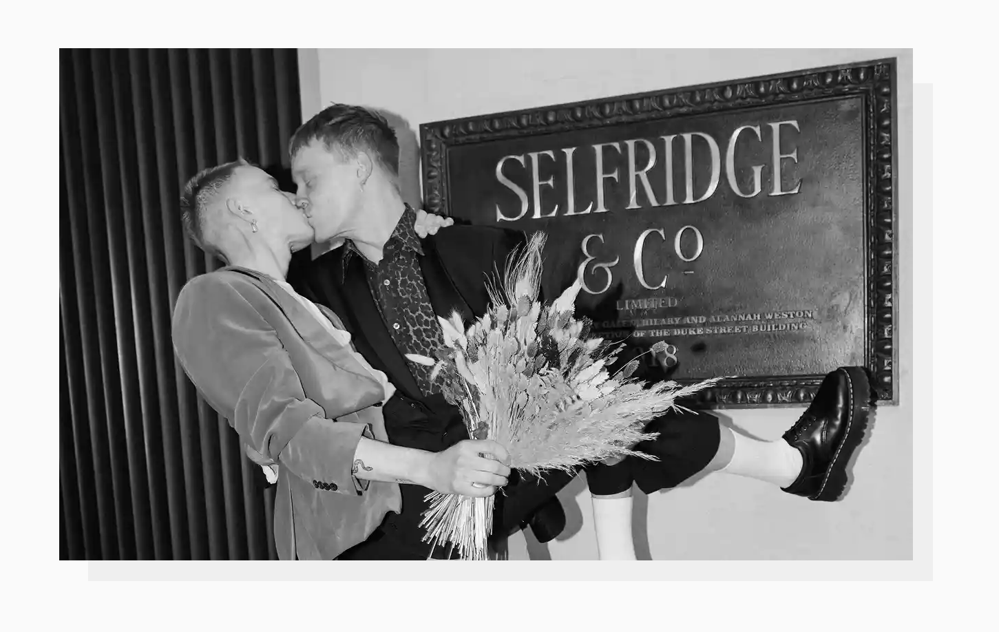 A photo of a happy couple kissing in the Selfridge store