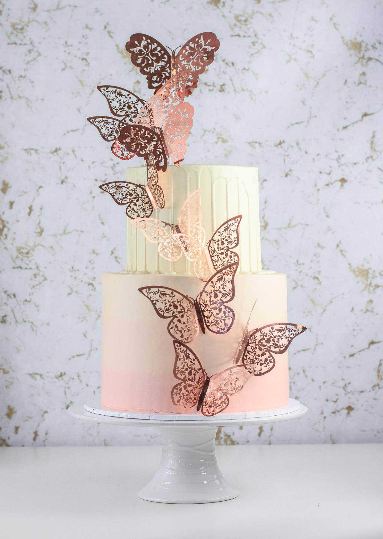 Two Tier Pastel Pink Ombre Cake with Rose Gold Butterflies