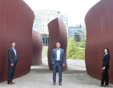 Seattle chic: Jonathan McQuade and Victoria Godyn flank Philip Palaveev.
