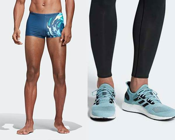 Man wearing blue water patterned swimshorts made from recycled fishing nets and plastic from sustainable sportswear brand Adidas Parley and Man wearing Adidas Parley pale blue Prime knit running trainers