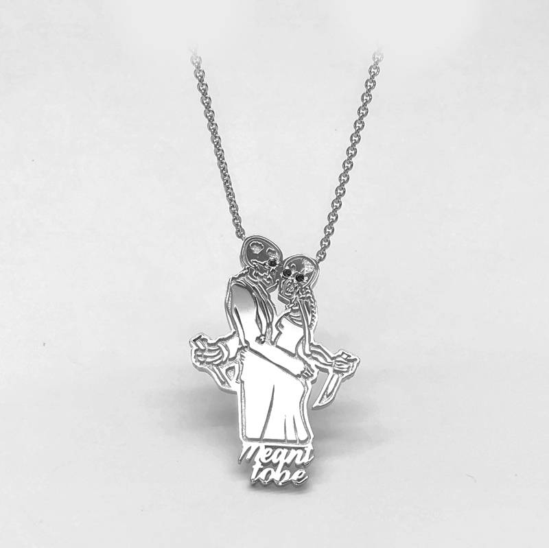 pendant skeleton characters kissing with writing meant to be