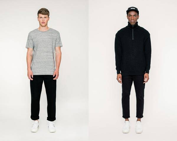 Man wears grey melange organic cotton t-shirt with black trousers and veja sneakers and man wears 1/4 zip jumper in black with black jeans and black 5 panel cap