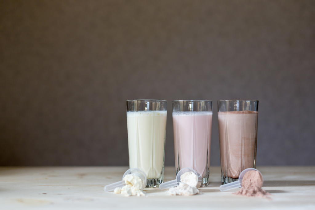 Three elemental diet shakes on a tabletop