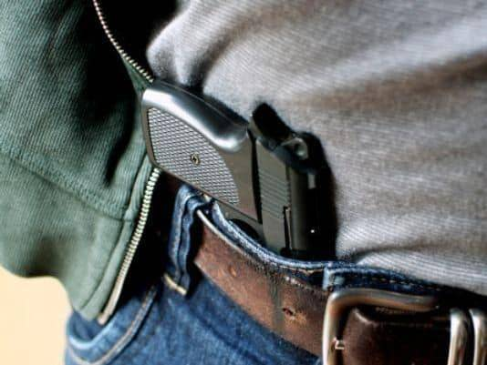 conceal carry without holster by tucking into the waistline