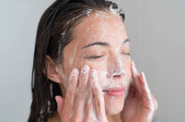 Woman using face wash