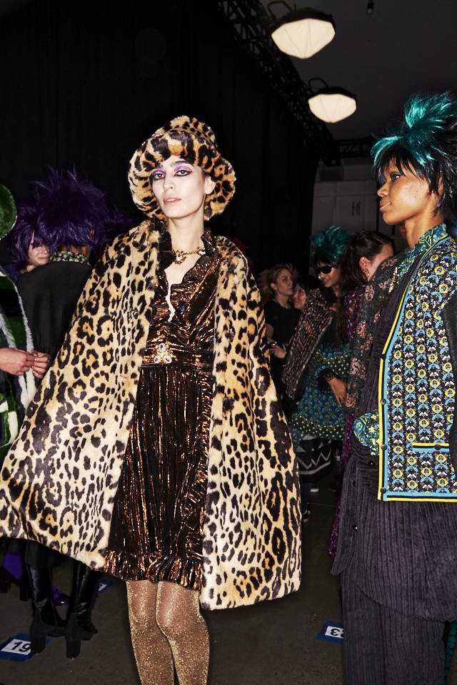 A model posing Behind the Scenes at the Anna Sui FW19 Fashion Show